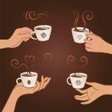 Ensemble de mains retenant des cuvettes de café Image stock