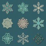 Ensemble de neuf flocons de neige tricotés cousus mignons de vecteur illustration stock