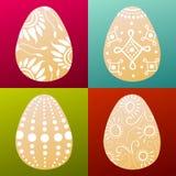 Ensemble de 4 oeufs de pâques peints colorés Photos libres de droits