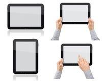 Ensemble de PC de tablette avec des mains Photographie stock libre de droits