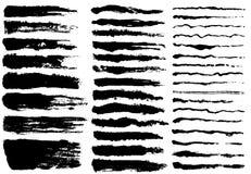 Ensemble de peinture noire, courses de brosse d'encre Photographie stock