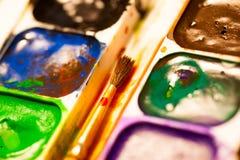 Ensemble de peintures d'aquarelle avec la brosse Images libres de droits