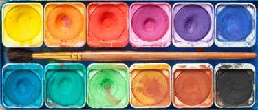 Ensemble de peintures et de pinceau d'aquarelle Image libre de droits