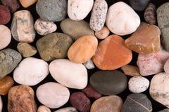 Ensemble de pierres sur un fond noir Photos stock