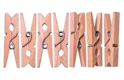 Ensemble de pinces à linge en bois d'isolement sur le fond blanc Photographie stock