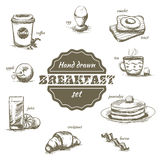 Ensemble de plats et de boissons tirés par la main de matin Image libre de droits