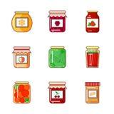Ensemble de pots avec du miel, la confiture et les légumes Photographie stock