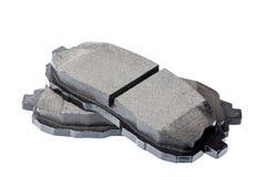 Ensemble de protections de frein, pièces de rechange de voiture d'isolement sur le blanc Photographie stock libre de droits