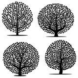 Ensemble de quatre arbres noirs avec des feuilles sur le fond blanc Image stock