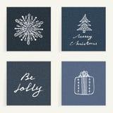 Ensemble de quatre cartes Cadeaux d'or tirés par la main sur les backgrouns bleu-foncé Vacances d'hiver Weihnachtspakete - cadeau Photos libres de droits