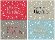 Ensemble de quatre cartes de Joyeux Noël avec des flocons de neige, calibres Photographie stock libre de droits