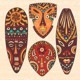 Ensemble de quatre masques africains Images libres de droits