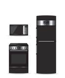 Ensemble de réfrigérateur et de fourneau noirs de micro-onde d'appareils électroménagers Photos libres de droits