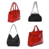 Ensemble de sacs femelles en cuir noirs et rouges photos stock