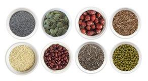 Ensemble de superfood d'isolement sur le fond blanc Superfood avec l'espace de copie pour le texte Graines de lin, pavots, harico Images libres de droits