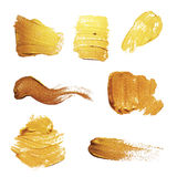 Ensemble de tache de course de calomnie de peinture d'or de vecteur Texture abstraite d'or Photographie stock