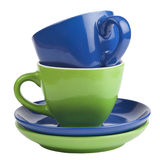 Ensemble de tasses et soucoupes vertes et bleues, d'isolement sur le blanc. Images stock