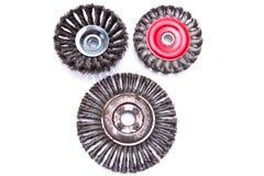 Ensemble de trois balais tournants en métal Images stock