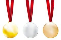 Ensemble de trois médailles en métal - or, argent, bronze Photo stock