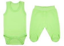 Ensemble de vêtements pour des bébés et des enfants, isolement Photographie stock libre de droits