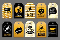 Ensemble de vecteur d'étiquettes et de labels avec l'inscription heureuse de Halloween Collection de fête de cartes Tout le fond  Photos stock