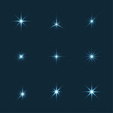 Ensemble de vecteur d'étoiles de lumières d'étincelle Photos stock