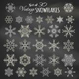 Ensemble de vecteur de 30 flocons de neige de craie Image libre de droits