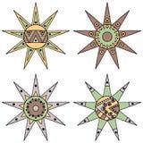 Ensemble du soleil tribal puéril de brun stylisé décoratif tiré par la main de vintage de vecteur avec des lumières Style de grif Photo stock