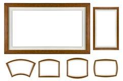 Ensemble en bois de cadre de tableau sur le blanc d'isolement Photographie stock libre de droits