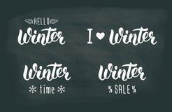 Ensemble handlettering d'hiver Logos et emblèmes d'hiver pour l'invitation, la carte de voeux, le T-shirt, les copies et les affi illustration de vecteur