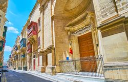 Ensemble of St Ursula street, Valletta, Malta. Ensemble of medieval St Ursula street includes the Baroque Church of St Roque and traditional edifices with bright Royalty Free Stock Image