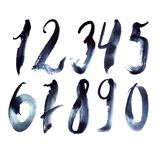 Ensemble tiré par la main avec des nombres bleu-foncé écrivant dans le style à main levée Photos libres de droits