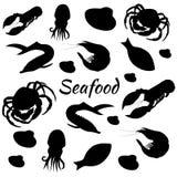 Ensemble tiré par la main avec les silhouettes noires de fruits de mer photos stock