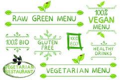 Ensemble tiré par la main d'éléments typographiques d'isolement sur le fond blanc Menu cru, de végétarien et de vegan végétarien Image stock