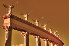 Ensemble of winged trumpeters. A row of roman winged goddesses with trumpets on a stand Stock Photography