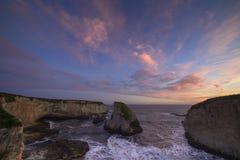 Ensenada de Sharkfin en la puesta del sol Fotografía de archivo