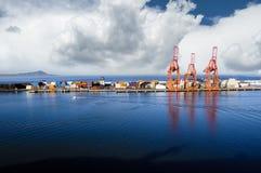 Ensenada Mexico. Bright red shipping cranes in Ensenada, Mexico with shipping containers Royalty Free Stock Photos