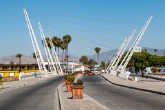 Decorative White Bridge in Ensenada, Mexico. ENSENADA, MEXICO - MAY 3, 2017: Decorative white bridge crossing the Arroyo Ensenada on Avenida Adolfo López Mateos royalty free stock photos