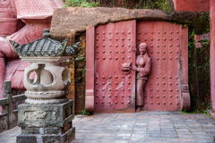 Enshi-Toasttoast Kaiserstadt neun in Hall schnitzte auf den Felsen Tujia-Leutestatuen Stockbild