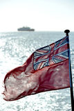 Ensign. British ensign with sea, sun and a ship royalty free stock photo