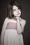 Ensive Little Girl against Grey Background Stock Photos