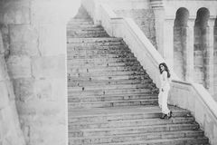 Ensual woman on staircase. Woman bride in white wedding dress, fashion. Girl with glamour look. Fashion model with long Royalty Free Stock Photos