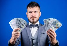 Ensuring his financial future. Bearded man hold cash money. Currency broker with bundle of money. Making money with his. Own business. Business startup loan royalty free stock photo