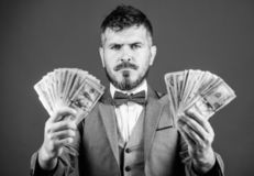 Ensuring his financial future. Bearded man hold cash money. Currency broker with bundle of money. Making money with his. Own business. Business startup loan royalty free stock image