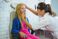 Ent doctor or Otolaryngologist examining a kid nose Royalty Free Stock Photography
