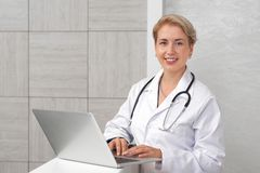 ENT doctor with stethoscope on neck posing and smiling. royalty free stock photography