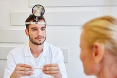 ENT physician in consultation. Listening to patient Royalty Free Stock Image