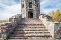 Entance of stone tower. Front entrace of a stone tower during autumn time Royalty Free Stock Photography