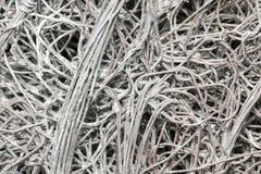 Entangled galvanised wire mesh. Closeup of entangled galvanised wire mesh stock photo