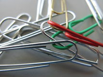 Entangled paperclips. A closeup of different colored paper clips, entangled Royalty Free Stock Images